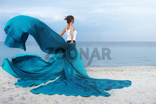 Beautiful Girl With  fabric on The Beach.