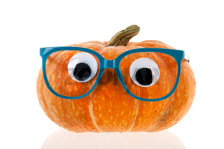 Funny pumpkin with eyes and blue glasses