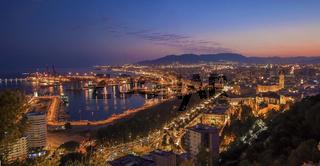 Panoramic night view of Malaga city, Spain