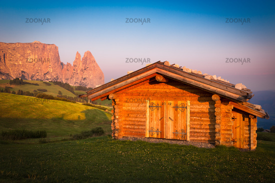 Cabin at Seiser Alm with Schlern mountain, South Tyrol, Italy