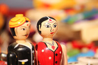 closeup of clay dolls in indian attire, selective focus