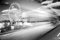 Bus passing tourists and London Eye in black and white, UK, United Kingdom