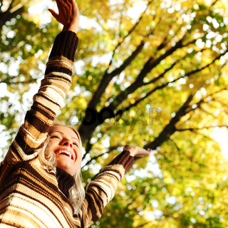 autumn woman hands in the air
