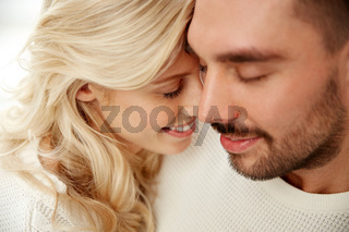 close up of happy couple faces with closed eyes
