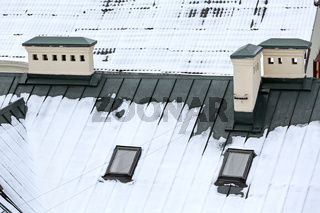 metal roof with skylights under snow