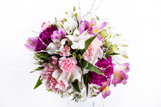 Bouquet from pink and purple gillyflowers and alstroemeria on white background