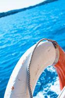 White life buoy on the boat fence