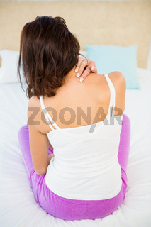 Rear view of a woman with neck pain