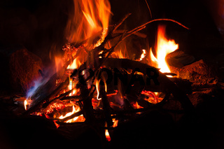 Campfire closeup at night with long exposure shot in the mountain Tajamulco