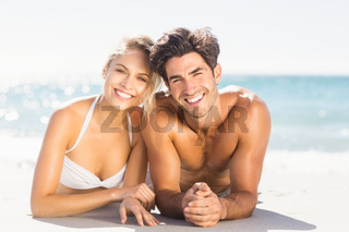 Young couple lying on beach