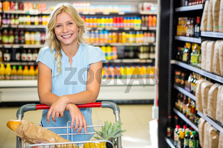 Portrait of beautiful woman pushing cart