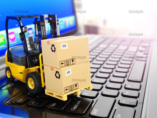 Concept of delivering, shipping or logistics. Forklift on laptop keyboard.