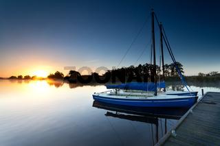 yachts on lake pier at sunrise