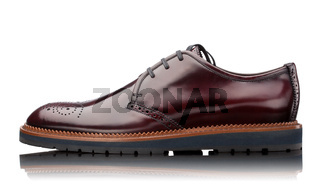 brown male leather shoe isolated on white