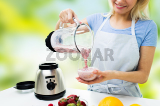 close up of woman with blender and shake at home