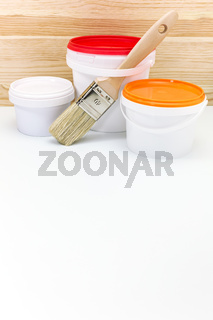 paint cans and brush for home renovation