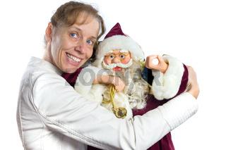 Caucasian woman embracing model of Santa Claus