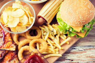 close up of fast food snacks on wooden table