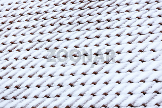 red tile roof with snow