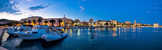 Split waterfront panorama in blue hour