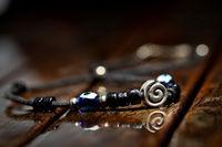 Hand made necklace on wodden wet background