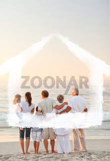 Composite image of beautiful family at the beach