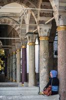 ISTANBUL, TURKEY - JULY 07: Muslim woman visiting Topkapi Palace on July 07, 2014, in Istanbul, Turkey