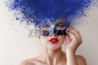 Fashion model with carnival mask