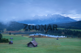 wooden hut on alpine meadows in morning