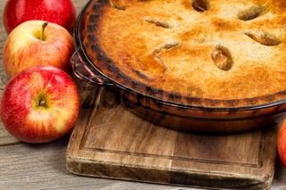 Freshly baked organic homemade apple pie on wooden server