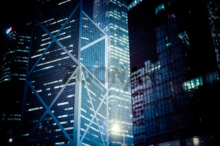 Futuristic night cityscape with illuminated skyscrapers. Hong Kong