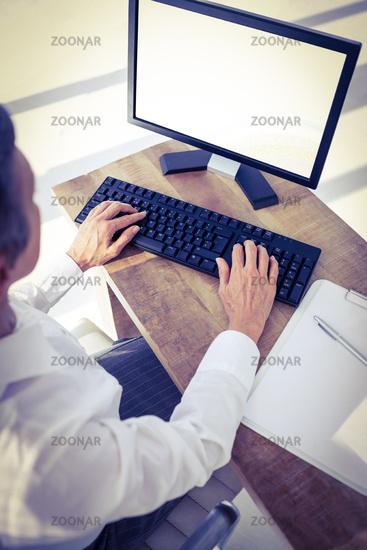 A businesswoman using her computer