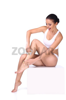 woman depilating her legs