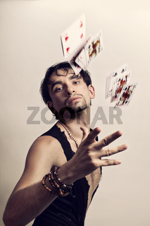 Man throws playing cards