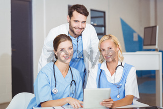 Portrait of cheerful doctor colleagues with digital tablet
