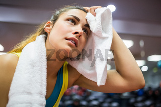 Woman drying her forehead from a workout