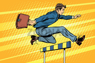 Businessman running hurdles