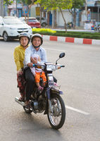 Vietnamese family with baby on motorcycle