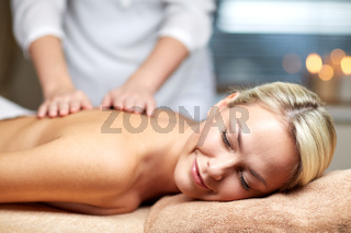 close up of woman lying and having massage in spa