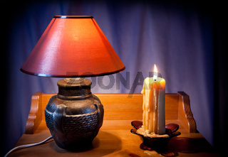 electrical night light lamp and burning candle