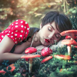 beautiful girl sleeping in forest