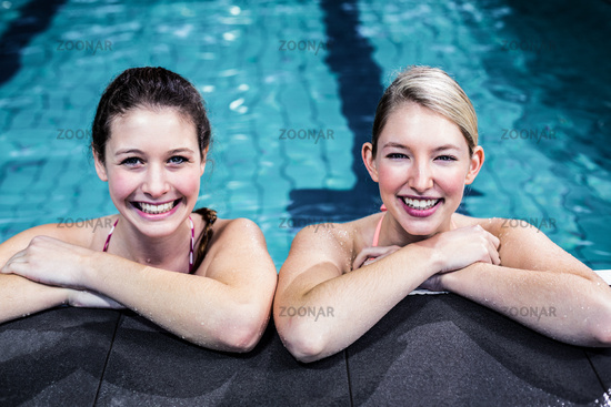 Happy group of women leaning on poolside