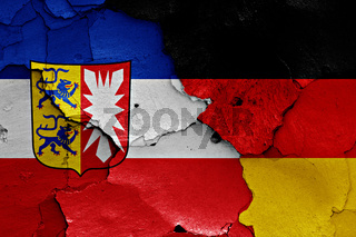 flags of Schleswig Holstein and Germany painted on cracked wall