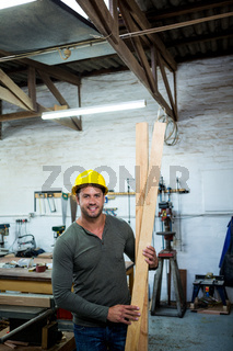 Carpenter is posing with his craft