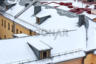 snow on the roofs of houses