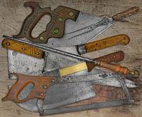 vintage butcher shop utensils over wooden table