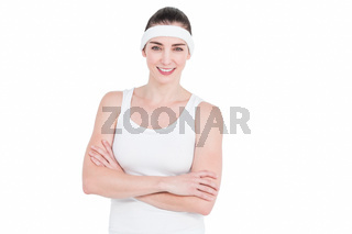 Female athlete posing with crossed arms