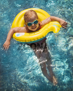 Happy child playing in swimming pool