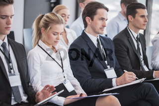 Business people making notes