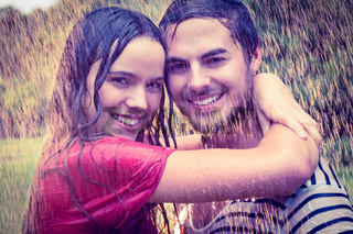 Cute couple hugging under the rain